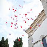 matrimonio vicenza fotografo chiesa palloncini colorati volano cielo